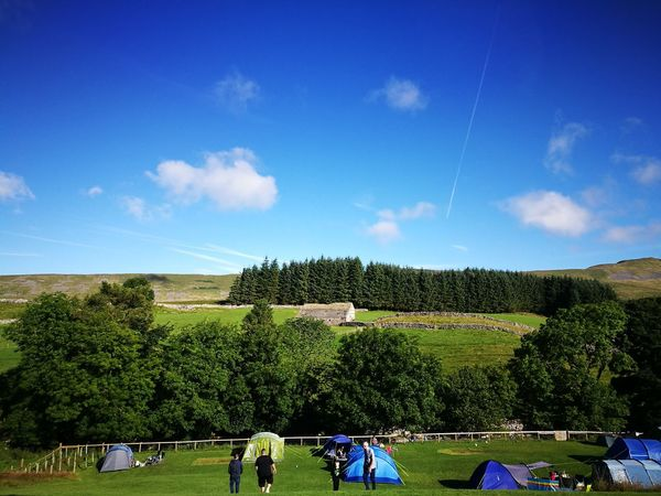 Outdoors Camping Rural Scene Field Camp Site Hillside Landscape Sky And Clouds