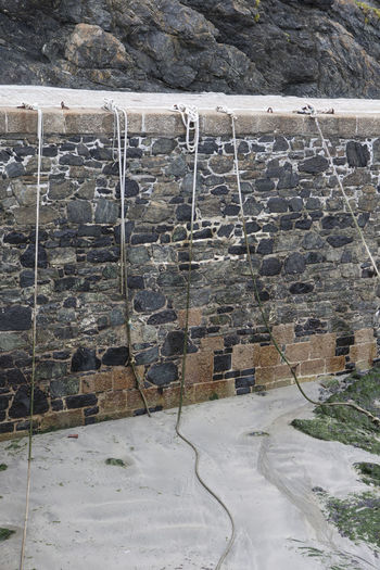 Harbour Lines Wall Day Mouring Mullion No People Outdoors Quey Roacks Roap Sand Stone Stone Wall