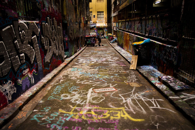 Architecture Graffiti Building Exterior Text Multi Colored Creativity City The Way Forward Incidental People Wall - Building Feature Art And Craft Built Structure Direction Communication Day People Street Choice Alley
