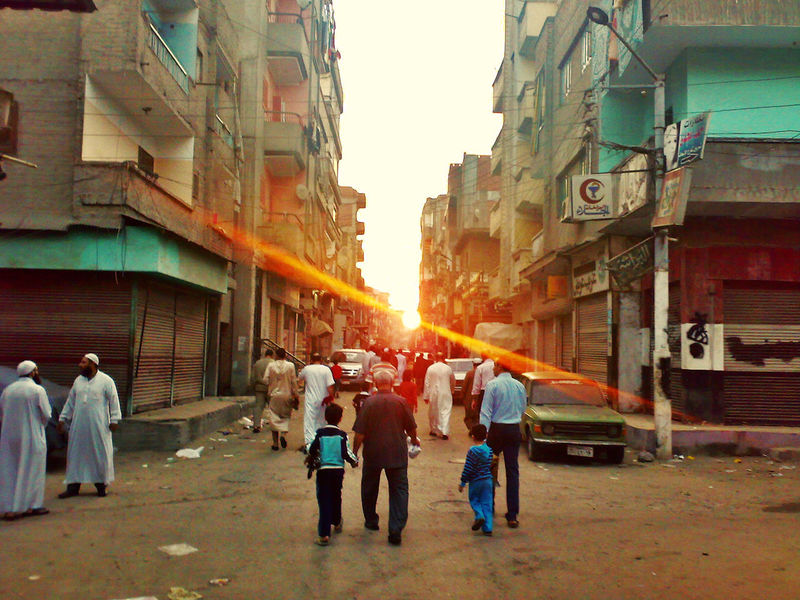 Road to Eid prayer Adult Adults Only Architecture Building Exterior Built Structure City Day Men Outdoors People Real People Rear View Sky Sunset The Street Photographer - 2017 EyeEm Awards Women