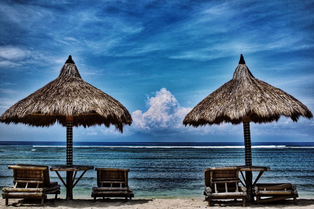 sea, beach, horizon over water, sky, tranquil scene, tranquility, water, nature, cloud - sky, sand, scenics, thatched roof, outdoors, beauty in nature, vacations, blue, day, no people