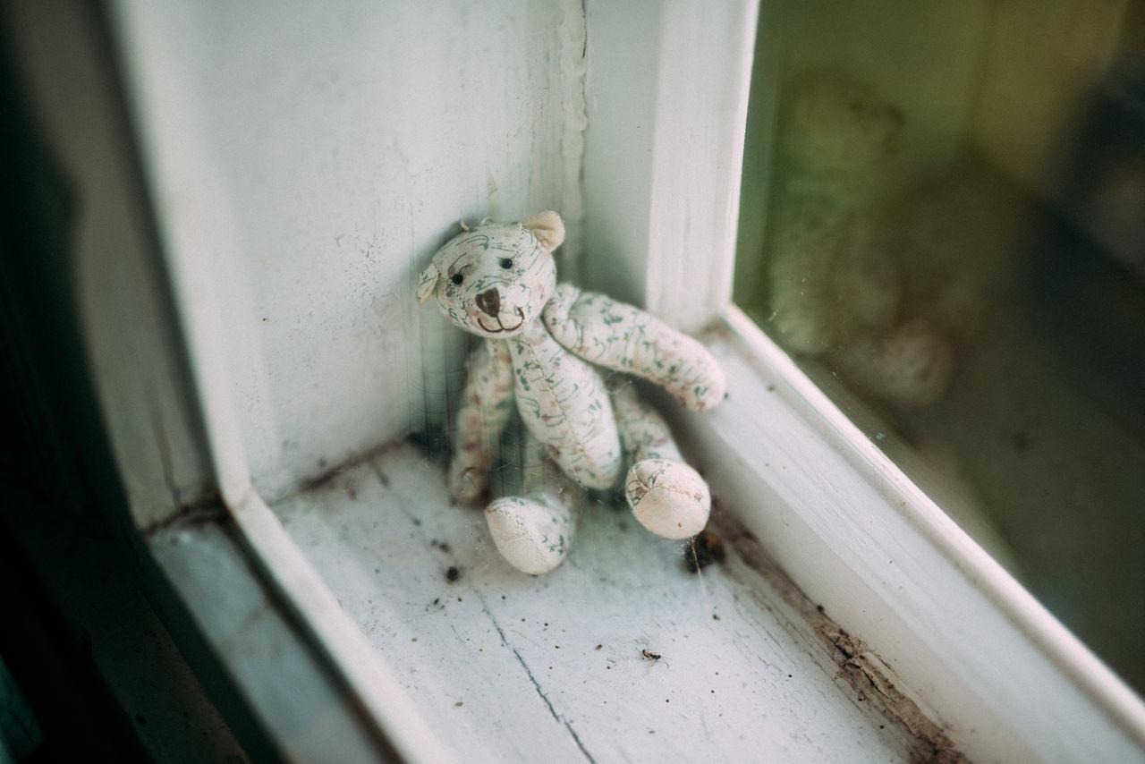High angle view of teddy bear on window sill