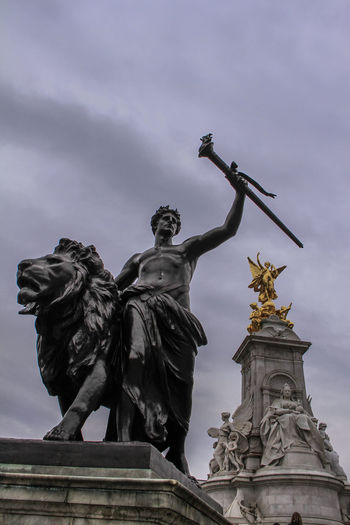 Angel Art Buckingham Palace Buckinghamfountain Capital Cities  Carving - Craft Product Cloud Cloud - Sky Cloudy Craft Creativity Day London LONDON❤ Low Angle View Monument No People Outdoors Sculpture Sky Statue Statue Tourism Travel Destinations Uk
