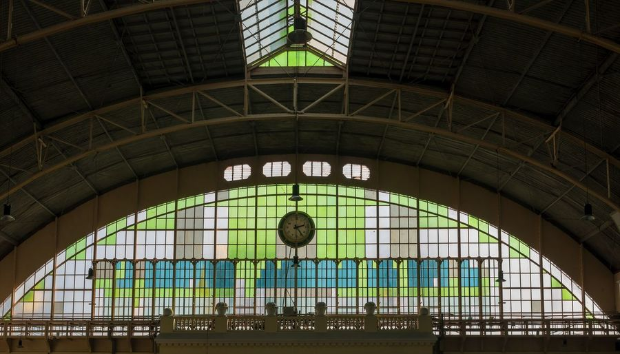 Architecture Built Structure Indoors  Text Day No People Western Script Railroad Station Communication Window Arch Low Angle View Glass - Material Script Non-western Script Travel Destinations Clock Rail Transportation Pattern Ceiling Thailand Bangkok Thailand. Transportation Train Station Platform Travel Photography