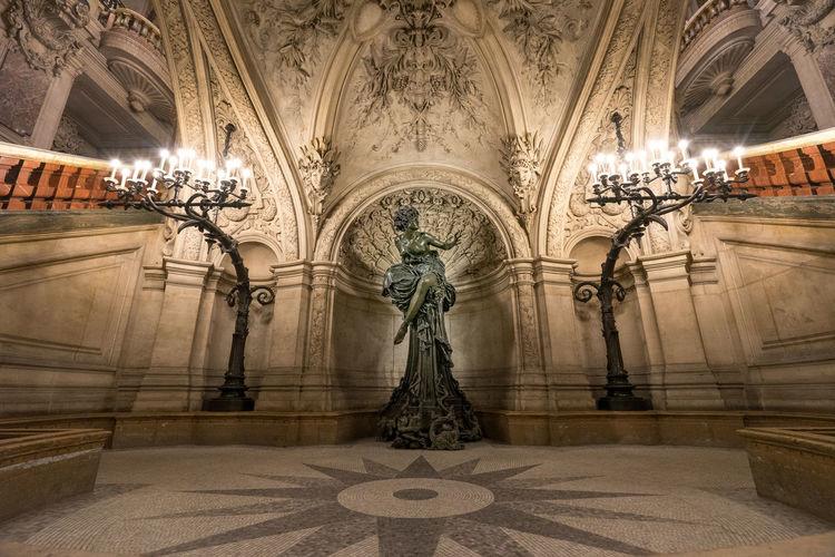 Statue of illuminated ceiling in building