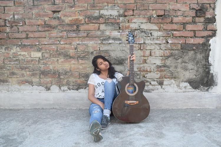 One Person Music Arts Culture And Entertainment Musical Instrument Full Length Real People Outdoors Architecture Day Built Structure People Portrait Musician Guitar Adults Only Young Adult Adult