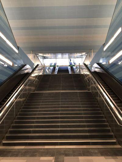 Low angle view of escalator at subway station