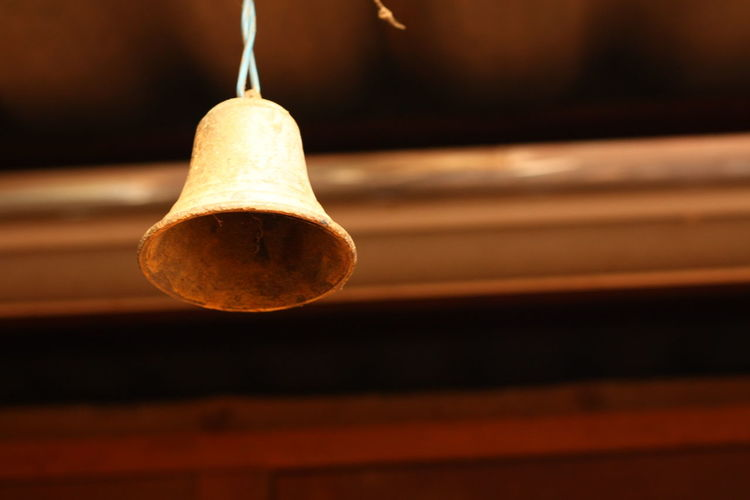 The bell chimes Brown Ceiling Close-up Decoration Electricity  Focus On Foreground Food And Drink Hanging Illuminated Indoors  Light Light Bulb Lighting Equipment Low Angle View No People Old Single Object Sphere Wall - Building Feature Wood - Material