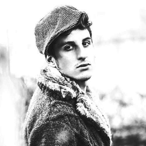 Portrait of handsome man wearing flat cap
