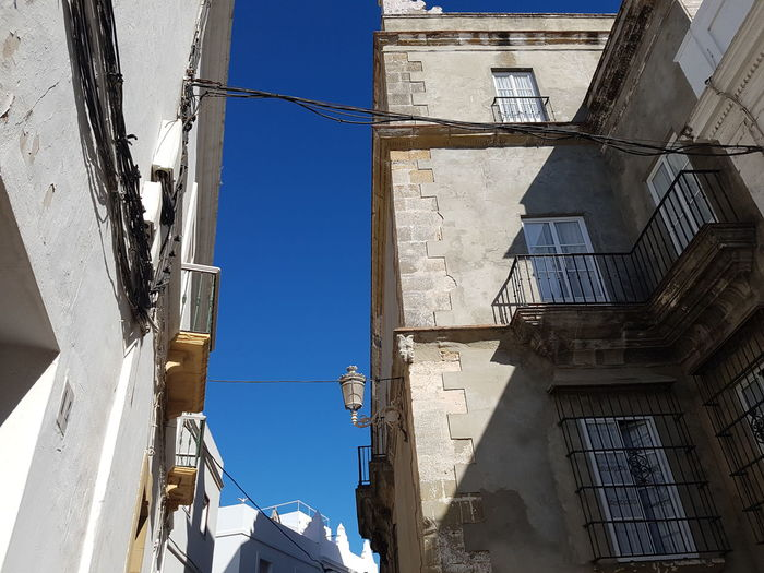 Architecture Built Structure Building Exterior Residential Structure Clear Sky Low Angle View Window Blue City Day Outdoors Façade Sunlight Andalusia Historic Tarifa Spain Tarifa Sunny Spanish Culture Sky Clear Sky Narrowstreet Old Town Narrow