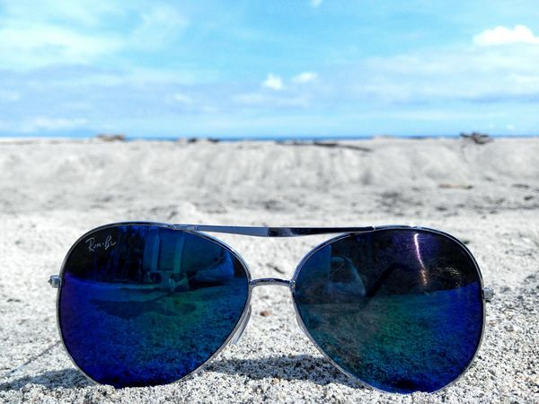 Life is a beach. Blue Sunglasseson Sand Sand And Sky Sand Dunes Beach Sunny Day Close-up Sky Outdoors EyeEm Nature Lover Life At Sea Eyem Philippines Eyeem Philippnes Mobile Phone Mobilephotography Mobile Photo Cloud - Sky No People @ Davao Occidental Philippines