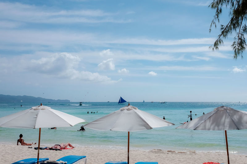 Philippines Relaxing Vacations Beach Beach Umbrella Beauty In Nature Boracay Cloud - Sky Day Horizon Horizon Over Water Land Nature Outdoors Parasol Sand Scenics - Nature Sea Shade Sky Tranquil Scene Tranquility Travel Destinations Umbrella Water