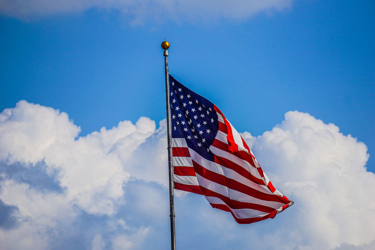 Low Angle View Of American Flag Against The Sky