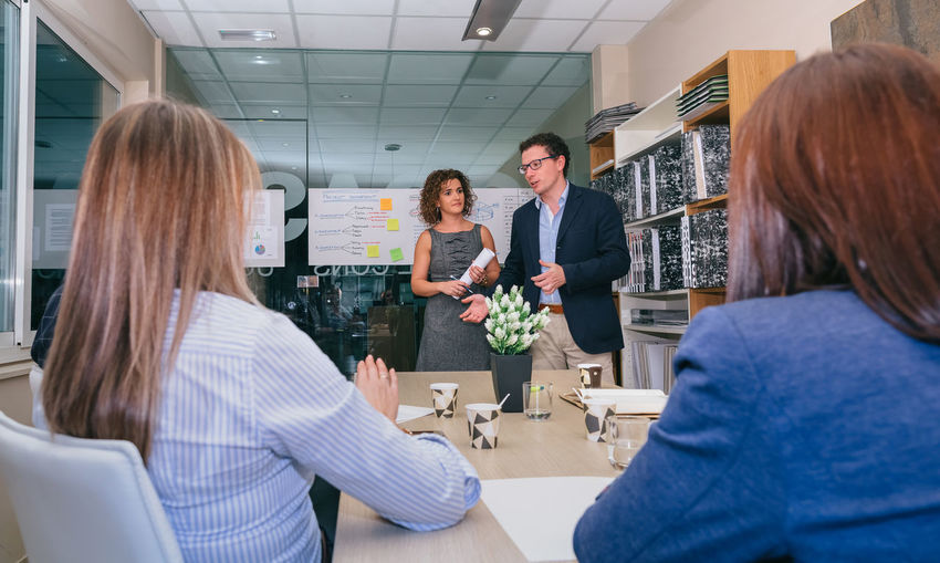 Businesswoman giving presentation in meeting at office
