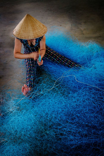 Fish-Net 2 EyeEmNewHere One Person Real People Blue Women Day High Angle View Casual Clothing Females Fishing Net Vietnam Vietnamese Working Repairing