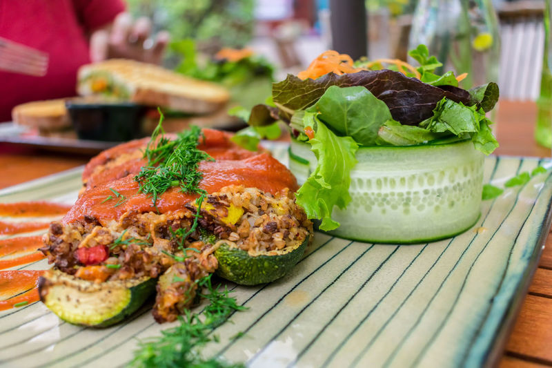 Lunch Vegetarian Food Al Fresco Close-up Day Focus On Foreground Food Food And Drink Freshness Garnish Healthy Eating Outdoors Plate Ready-to-eat Seating Table