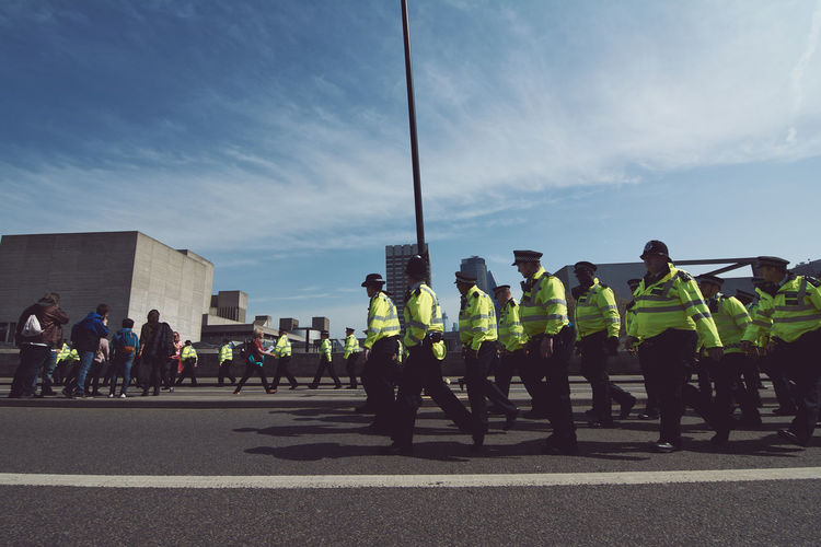 Extinction Rebellion - London 2019 Extinction Rebellion Protest Protesters London Group Of People Real People Large Group Of People Crowd Clothing Men Road Uniform Street Sky Day Transportation City Government Lifestyles Road Marking Marking Women Architecture Outdoors
