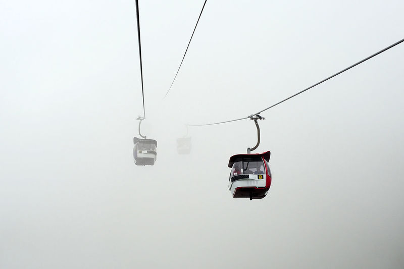 Genting Highlands Sky And Clouds Beauty In Nature Cable Cable Car Cold Temperature Connection Day Electricity  Fog Hanging Mist Mode Of Transportation Nature No People Outdoors Overhead Cable Car Ski Lift Sky Skyscraper Snow Transportation Travel Winter