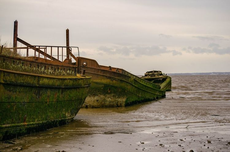 Abandoned Barge Beach Boat Day Low Tide Nautical Vessel No People Old Boat Outdoors Rusty Sea Ship Transportation Water