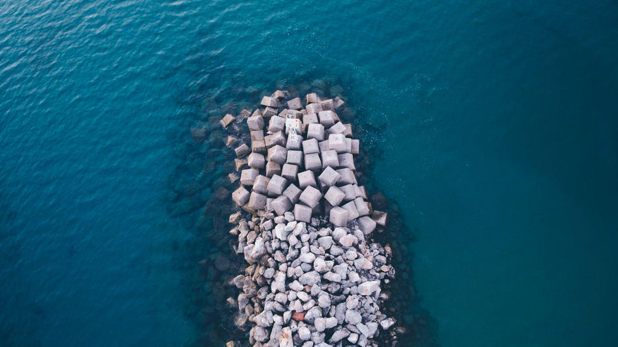 High angle view of wave breaker in sea
