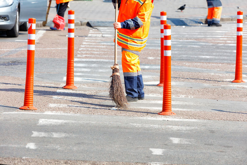Low section of person working on road
