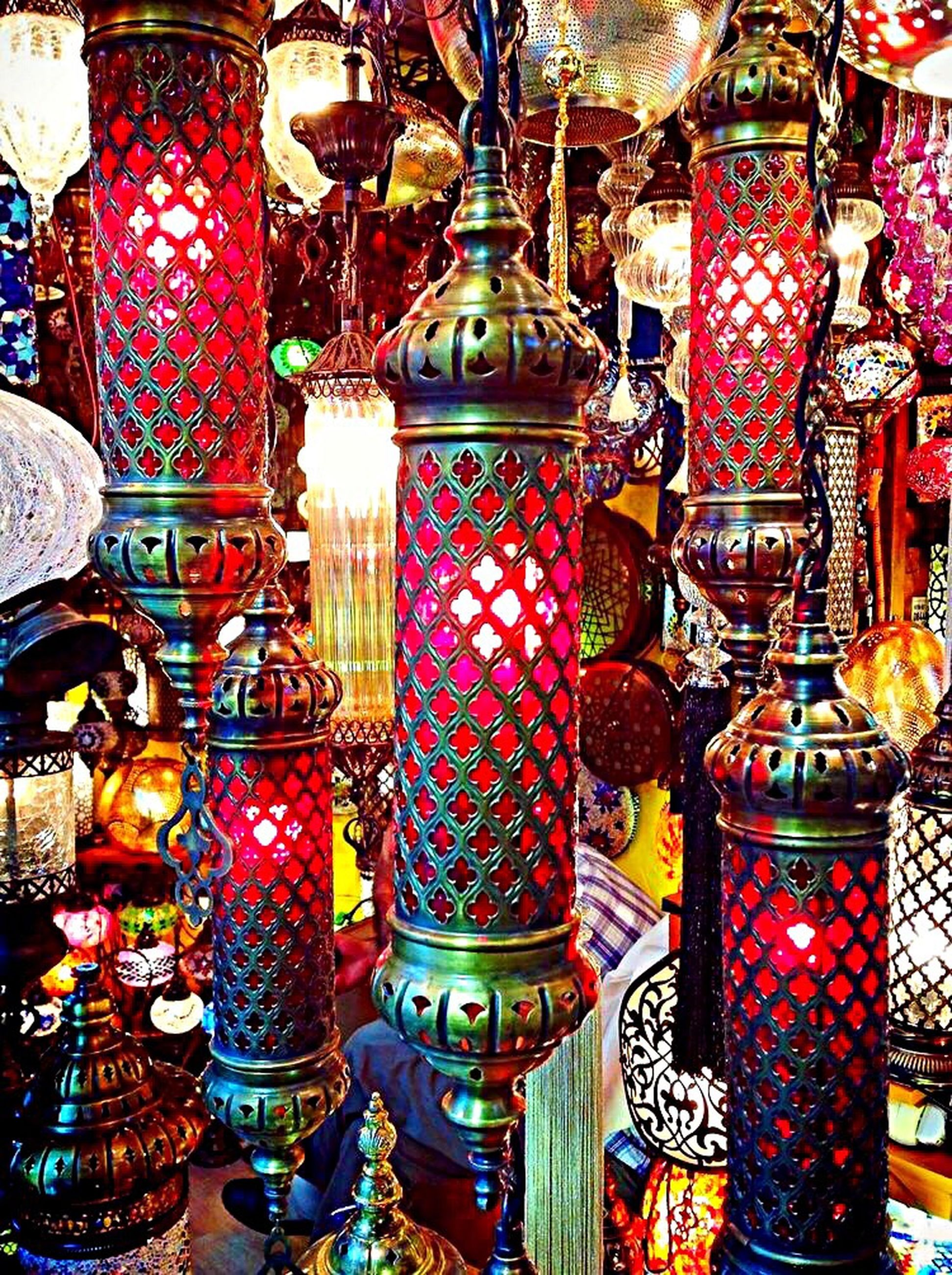 indoors, large group of objects, hanging, retail, abundance, for sale, metal, arrangement, variation, lighting equipment, store, no people, multi colored, in a row, choice, still life, decoration, illuminated, built structure, full frame