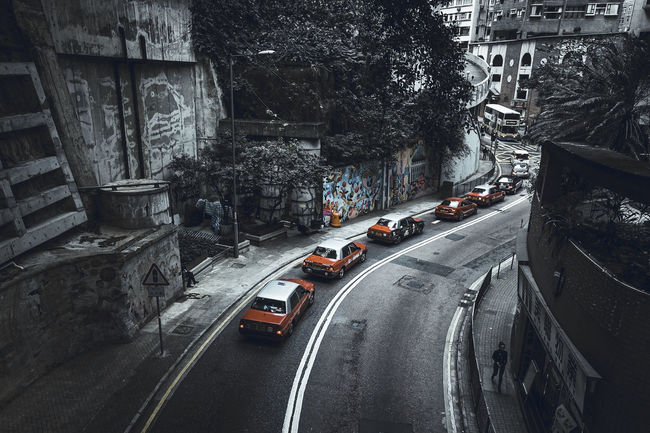 Graffiti Hong Kong Leading Lines Midlevel Esclator Pop Of Color Red Taxi Car Curved Road Midlevels Road The Way Forward