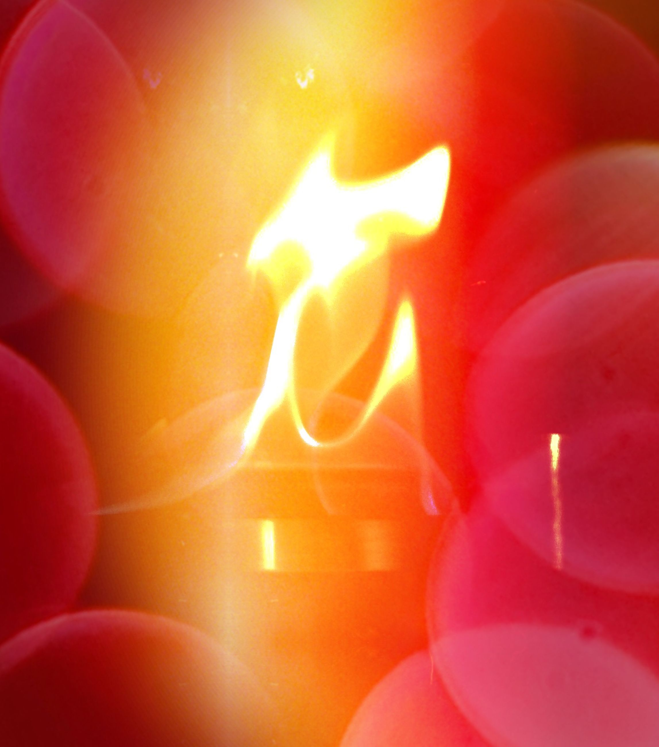 red, indoors, full frame, glowing, backgrounds, close-up, orange color, flame, burning, no people, candle, heat - temperature, fire - natural phenomenon, illuminated, high angle view, pattern, celebration, vibrant color, still life, pink color