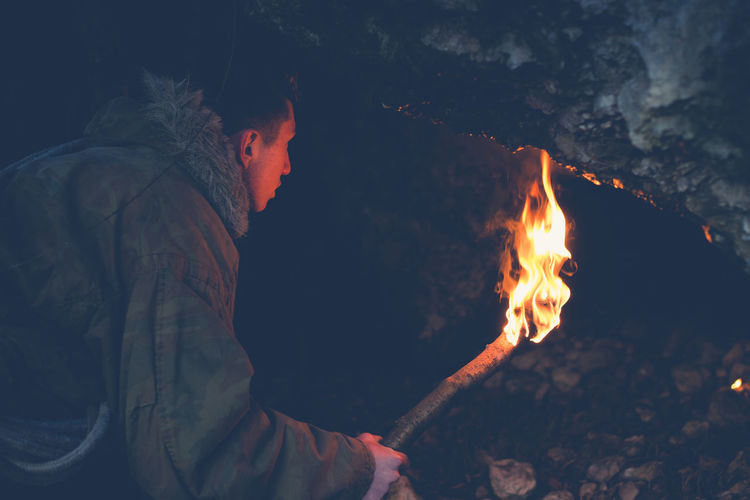 young boy exploring a cave Exploring Lifestyle Adventure Adventure Time Burning Cave Cavern Exploration Explorer Fire Flame Nature One Person Outdoors People Real People Torch
