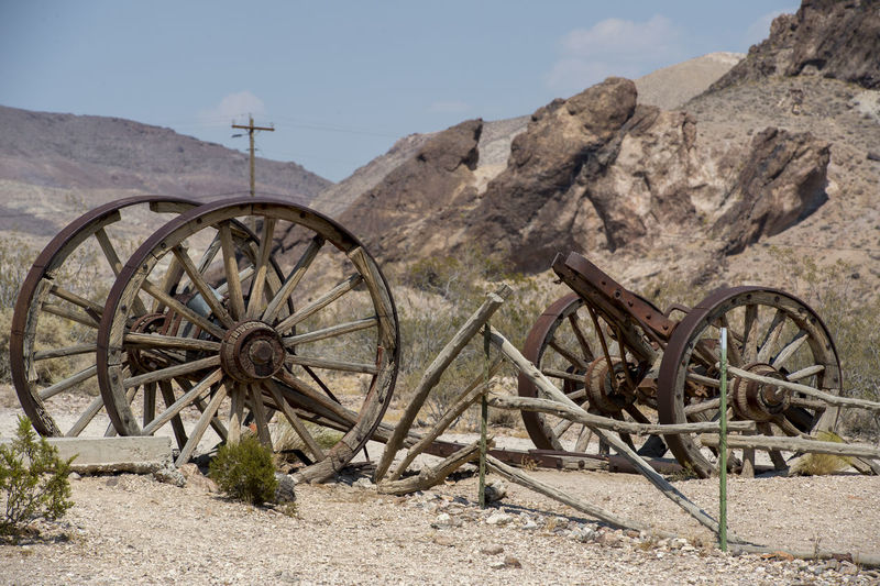 Abandoned Abandoned Places Agricultural Machinery Agriculture Cart Damaged Day Desert Deserted Firewood Heap Land Vehicle Mode Of Transport Mountain Obsolete Old Outdoors Rural Scene Stationary Stone - Object The Past Transportation Vineyard Wheel Wheel