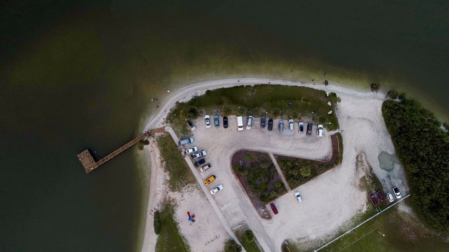 High angle view of parking lot by sea