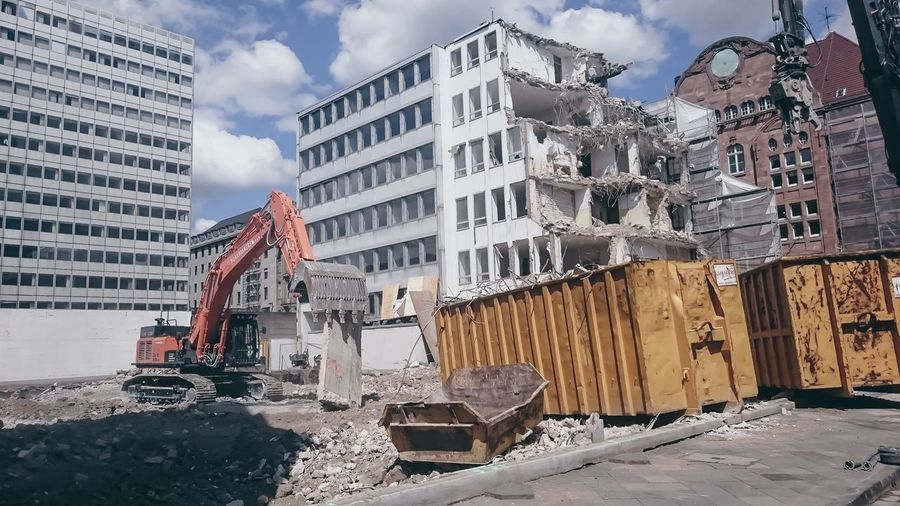 Building Being Demolished By Bulldozer
