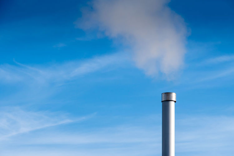 Production Air Pollution Blue Building Exterior Chimney Cloud - Sky Day Emitting Environment Environmental Damage Environmental Issues Factory Fumes Industry Low Angle View Nature No People Outdoors Pollution Sky Smoke - Physical Structure Smoke Stack