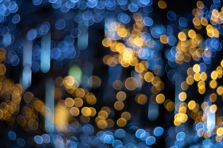 Abstract circular bokeh of light blurred background in night time Night Illuminated Defocused Circle Glowing Geometric Shape Shape Pattern Lens Flare Lighting Equipment No People Decoration Christmas Celebration Backgrounds Light - Natural Phenomenon Christmas Decoration Full Frame Light Design Abstract Electricity