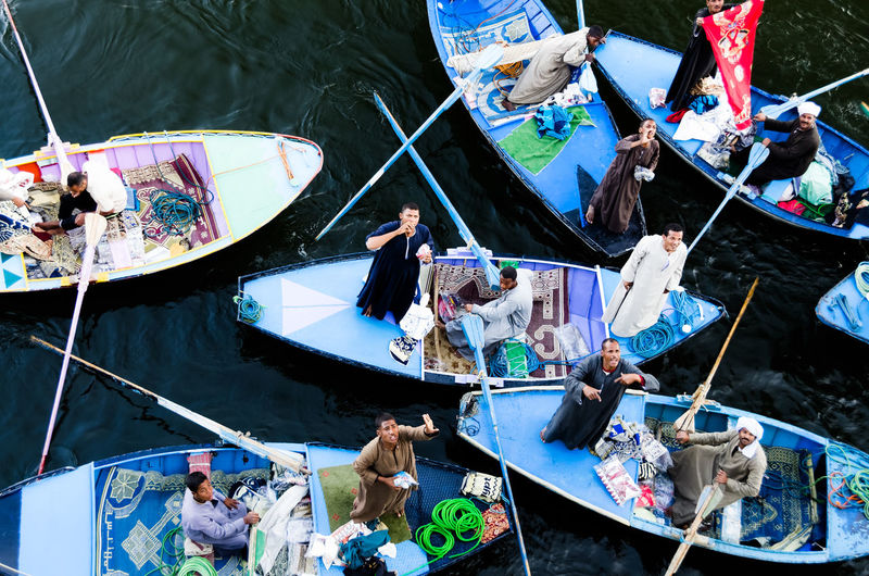 Salesmen in Egypt on the Nile river Boats Egypt High Angle View Merchandise Multi Colored Nile River Outdoors Salesman Bargaining Water People Together People And Places Dramatic Angles People EyeEm Diversity