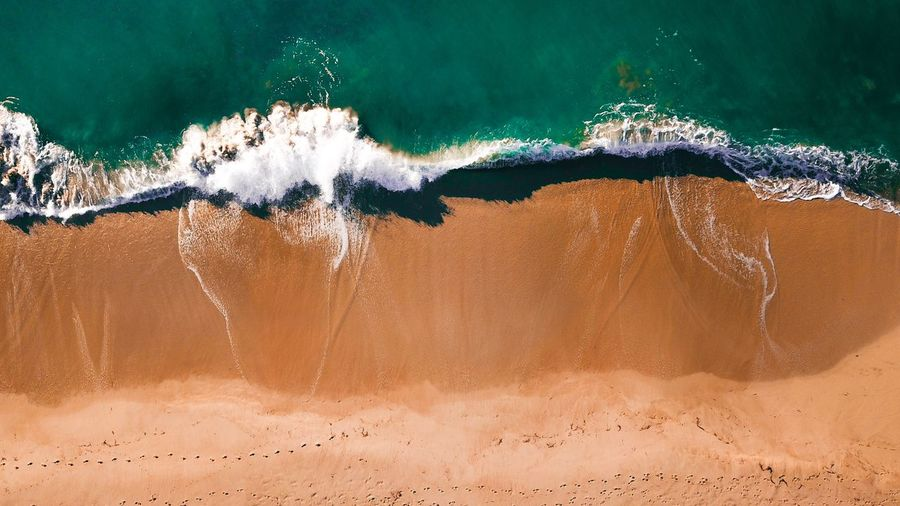 High Angle View Of Surf On Sea Shore