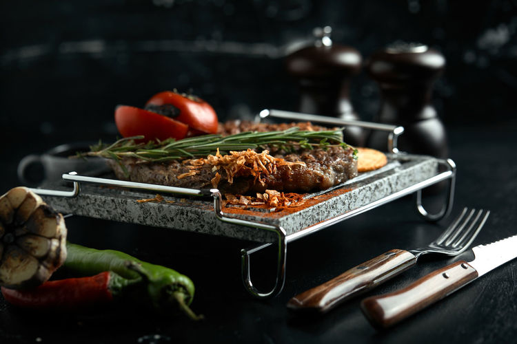 Close-up of meat in cooking pan on table