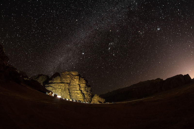 Camp in Wadi Rum village at night Night Star - Space Sky Space Scenics - Nature Astronomy Beauty In Nature Nature Tranquility Mountain Tranquil Scene Galaxy Architecture No People Idyllic Outdoors Rock Formation Star Star Field Illuminated Jordan Wadi Rum