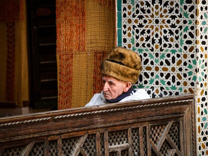 Portrait of man sitting in hat
