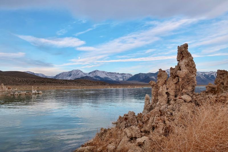 Landscape of tufa formations, Mono Lake and mountains Tufa Mono Lake Water Mountain Scenics - Nature Sky Beauty In Nature Cloud - Sky Land Mountain Range Tranquility Day Beach Sea Non-urban Scene No People Outdoors Holiday Tranquil Scene Snowcapped Mountain Nature