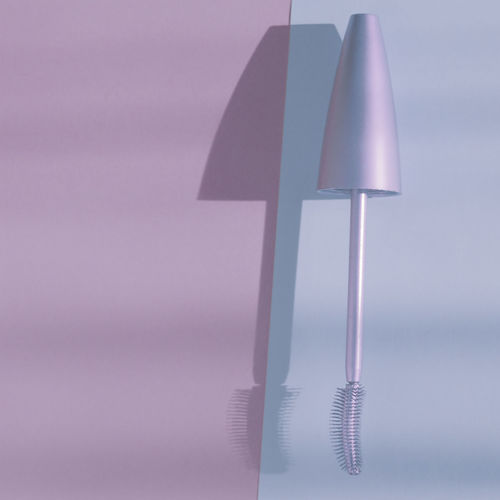 Close-up of electric lamp against sky
