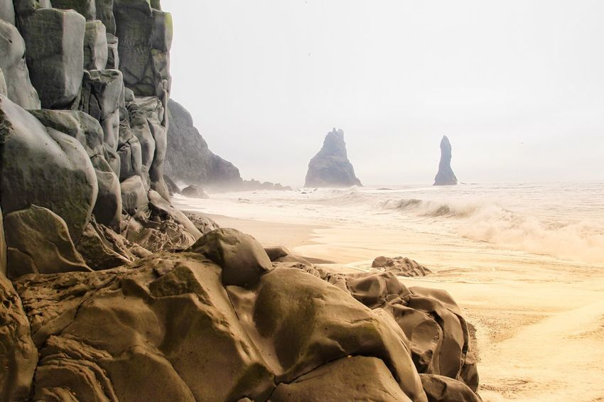 Vik, iceland Rock - Object Sand Sea Rock Formation Beach Nature No People Tranquility Beauty In Nature Day Outdoors Scenics Iceland Horizon Over Water Vík í Mýrdal Vik Rock EyeEm Nature Lover Landscape_Collection Landscape Travel Destinations Eye4photography  The Week On EyeEm Reynisdrangar Wave