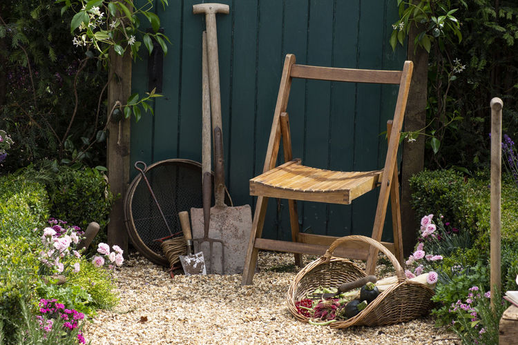 Potted plants in basket on table at yard