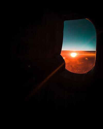 Sunset seen through airplane window