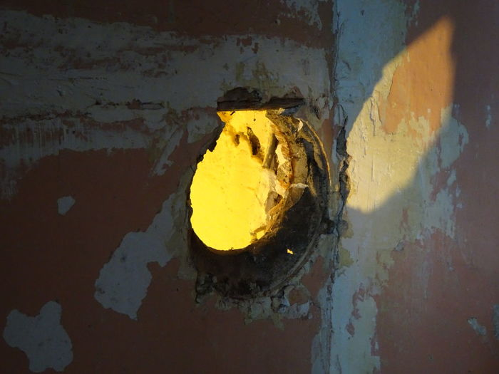 Decorating Dirty Full Frame Hole, Circle Light, Light And Shadow No People Old Painting And Decorating Peeling Plasterboard, Plastering Wall - Building Feature Weathered Yellow