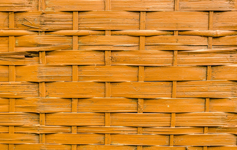 Close-up of orange painted bamboo wood strips woven background. Backgrounds Bamboo Wood Close-up Design Detail Full Frame Grid Interlocking No People Orange Color Pattern Repeat Repeating Patterns Repetition Texture Textured  Textures And Surfaces Traditional Weave Weaved Wood - Material Wooden Strips Woven Woven Bamboo Woven Pattern