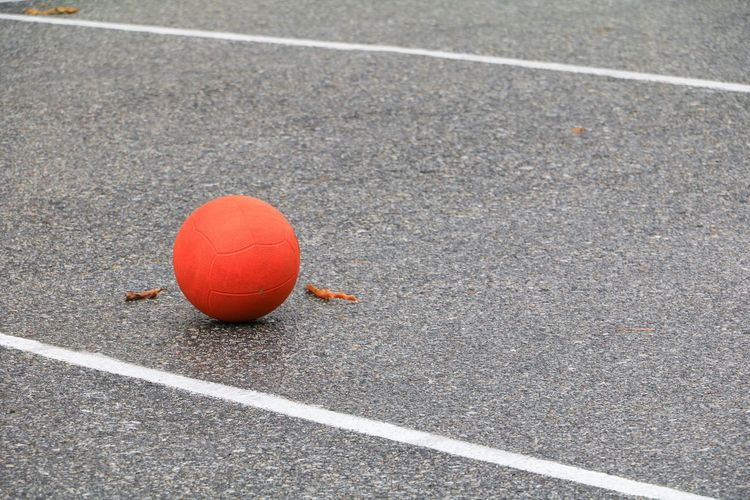 basket for playing chairball game wet field asphalt. Asphalt Background Ball Championship Competition Competitor Copy Country Cup Equipment Football Game Goal Kick Light Match Object Orange Play Professional Recreation  Round Score Soccer Space Text Wet