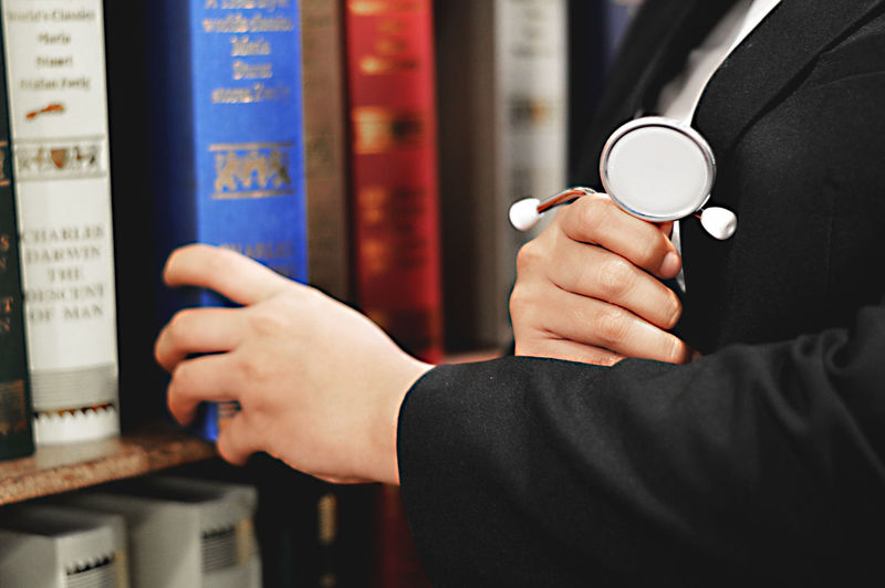 Library Focus On Foreground Food And Drink Hand Holding Human Hand Indoors  Lifestyles Men Mug Occupation One Person Real People Refreshment Stethoscope  Technology