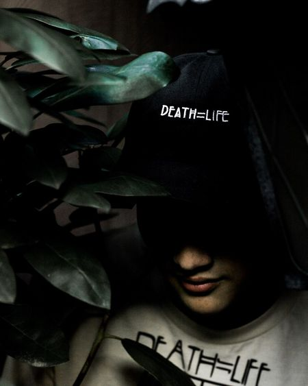 Headshot Dark Text Indoors  Young Adult Close-up Portrait People One Person Adult Fashion Eyes Closed  Shadow Front View Human Body Part Human Face Hat Lifestyles Fun Tree Adults Only Adult Plant