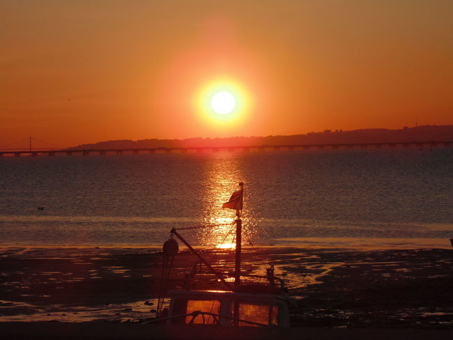 Sunset in Alcochete, Portugal. Beach Beauty In Nature Horizon Over Water Nature Nautical Vessel No People Orange Color Outdoors Scenics Sea Silhouette Sky Sun Sunlight Sunset Tranquility Water